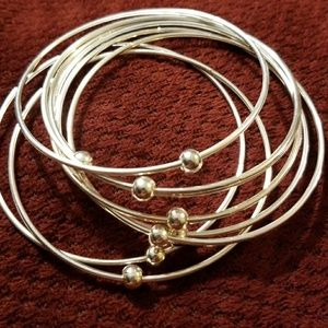 Jewelry - 7 silver beads on thin bangles