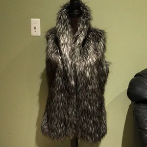 Woman's fur vest black and white size small used