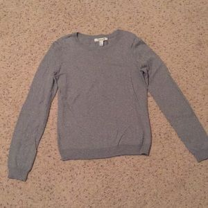 Grey sweater with brown corduroy elbow patches