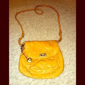 Roxy crossbody bag. Tan/peach color.