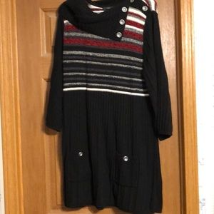 Black sweater with red, gray, and cream stripes