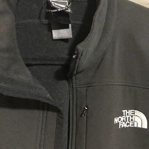 North face sweater no hood. Repellant fabric.
