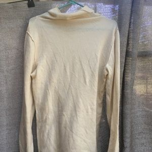 Cream turtle neck cashmere sweater
