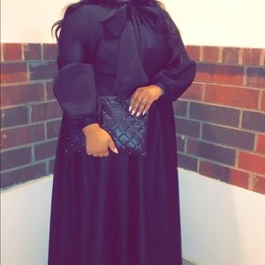 Plus size black free flowing maxi dress with bow