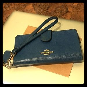 Blue Coach snap wristlet with gold accents