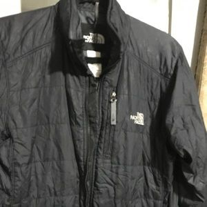 North face quilted jacket. Used. Some wear.