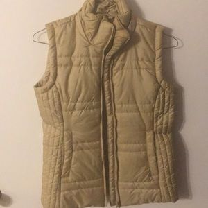 New York and company. Gold vest