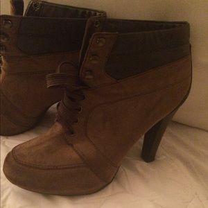 Boots by Nicole. Never worn size 7.5. Attractive