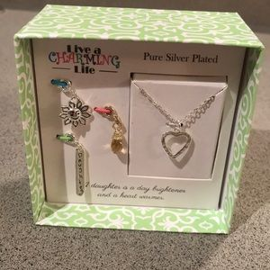 NWT! A heart necklace with interchangeable charms
