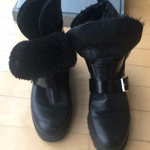 Black biker boots with faux fur insides.