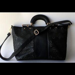 8 by Under One Sky Lasercut black satchel like new