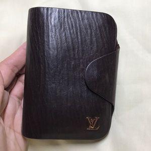 Vintage Louis Vuitton Brown leather unisex wallet.