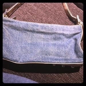Fendi denim bag with nails on bottom and strap .