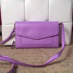 A small crossbody handbag (purse)