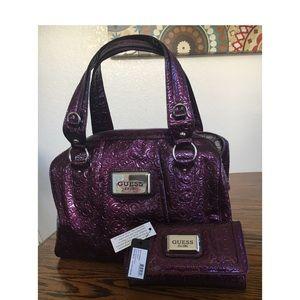 Deep purple Guess purse. New-Wallet still has tags