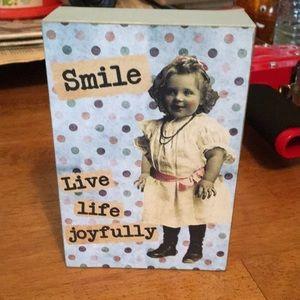 Inspirational wooden sitter. Smile live life
