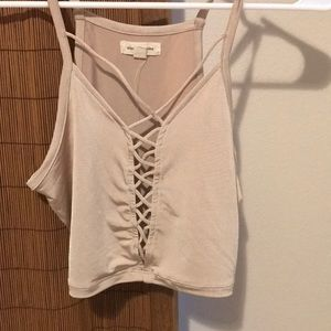 Cream lace up crop top. Size S