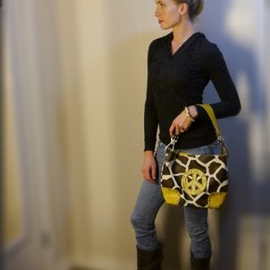 Leather giraffe print shoulder bag with peace sign