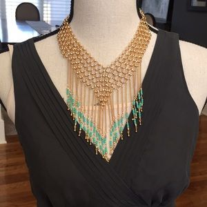Jewelry - Gold and turquoise necklace.