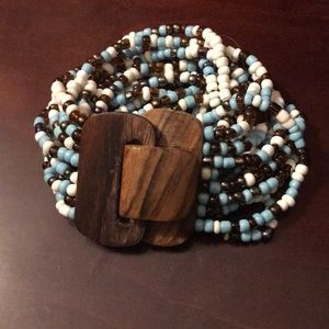 Beaded bracelet with wooden clasp