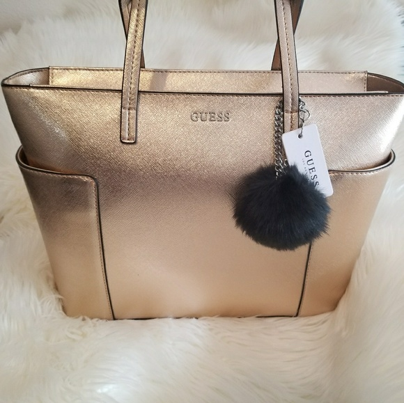 f7c4f5b3833 Guess Bags   Nwt Rose Gold Tote With Pom   Poshmark
