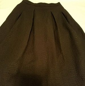 Black knee length skirt with pockets