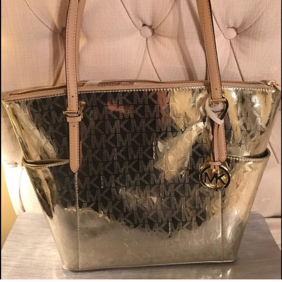 581bbe64695a ... discount code for michael kors bags mk gold tote poshmark 2c5e2 253c8