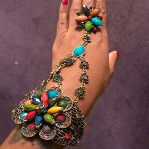 Bracelet with attached ring.