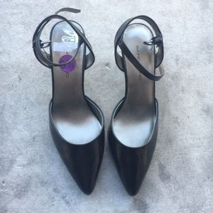 Black sling back heels with a closed pointed toe.
