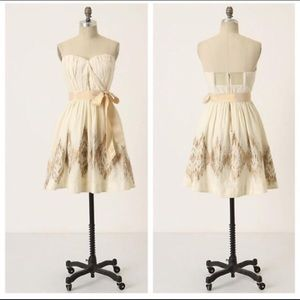 A Moulinette Soeurs cream and gold strapless dress