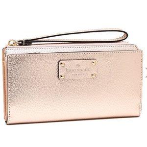 Kate spade rose gold wristlet wallet