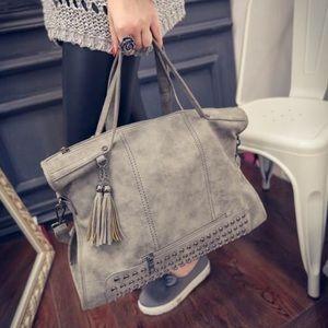 Gray studded handbag
