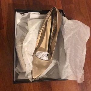 Nude satin pointed toe heels