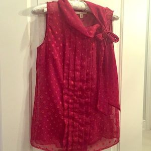 Beautiful Red sleeveless blouse. On trend