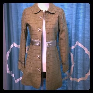 Green coat with pearl buttons