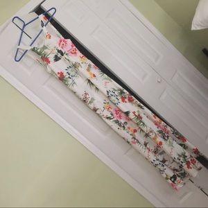 A must see. Beautiful open back dress. Maxi dress