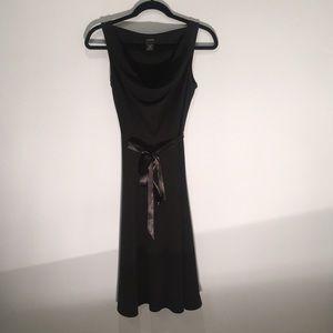 Black knee-length dress.
