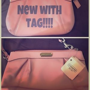 New with tags- pink coach wristlet clutch