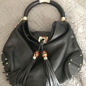 Gucci - authentic indie black leather hobo bag.