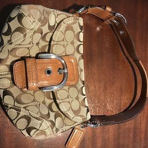 Brown signature coach purse.