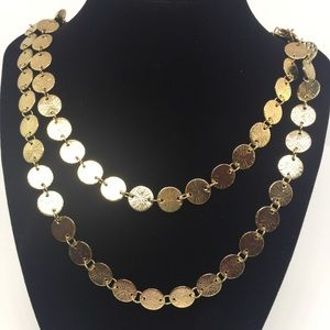 Gold costume necklace.