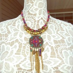Pink, blue and gold necklace.