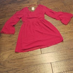 Red dress with flared sleeves and lace trim