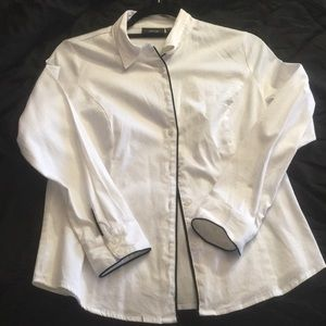 White button down shirt with black trim.
