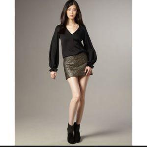 Black mini skirt with gold detail