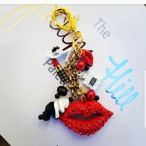 One of a kind gold purse charm