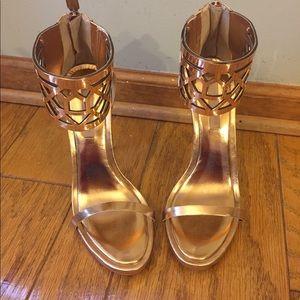BCBG MAXAZRIA gold stilettos