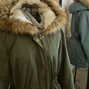 Army between long winter jacket