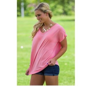 EUC pink Piko v-neck top
