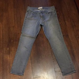 Ankle length gray colored jeans
